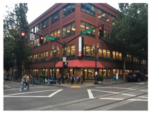 Powells bookstore from the front with people entering the building