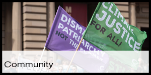Purple and green flag from a climate justice protest
