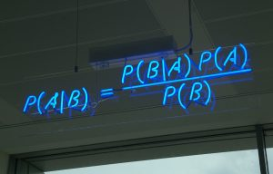A blue neon sign showing the simple statement of Bayes's theorem at the offices of HP Autonomy