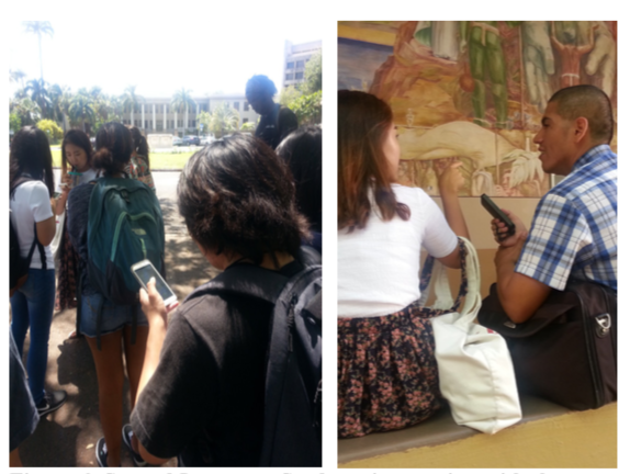 "Left: This vertical color photograph, taken during a field test of the Manoa Public Art app, shows a half-dozen students in the foreground and the Varney Circle fountain and Hawaii Hall in the background. The students are looking at their smartphones and engaging with the locative media that the app provides in that place. Right: A horizontal color photograph, this image shows two students, different students from the first image. They are seated on a bench with the ""Air"" mural in the background, conducting another field test of the Manoa Public Art app. The male student in the middle is holding his smartphone and talking with a female student to his left."