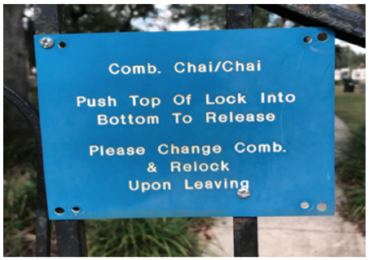 "This image shows a sign attached to the front gates of the B'nai Israel Cemetery. The sign reads: ""Comb. Chai/Chai 