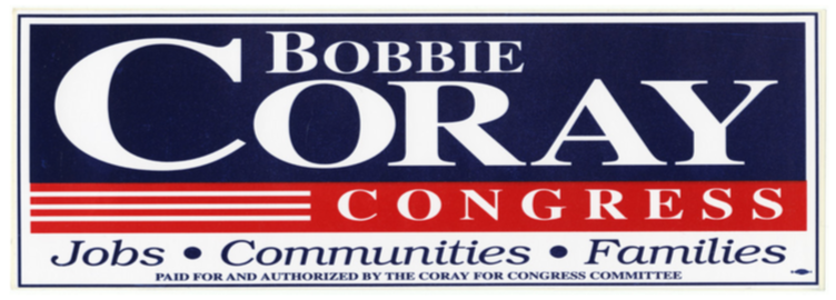 Coray for Congress Bumper Sticker. Coray is spelled with white lettering on a blue background. Congress is spelled with white lettering on a red background with white stripes to the left. The words jobs, communities, and families rest below the word Congress and are in blue lettering on a white background with dots in between each word. At the very bottom is a disclaimer in very small blue font that reads paid for and authorized by the Coray for Congress Committee. There is a union bug in the bottom right corner that signifies the sticker was printed by a union shop. Finally, a blue rectangle border outlines the entire design.