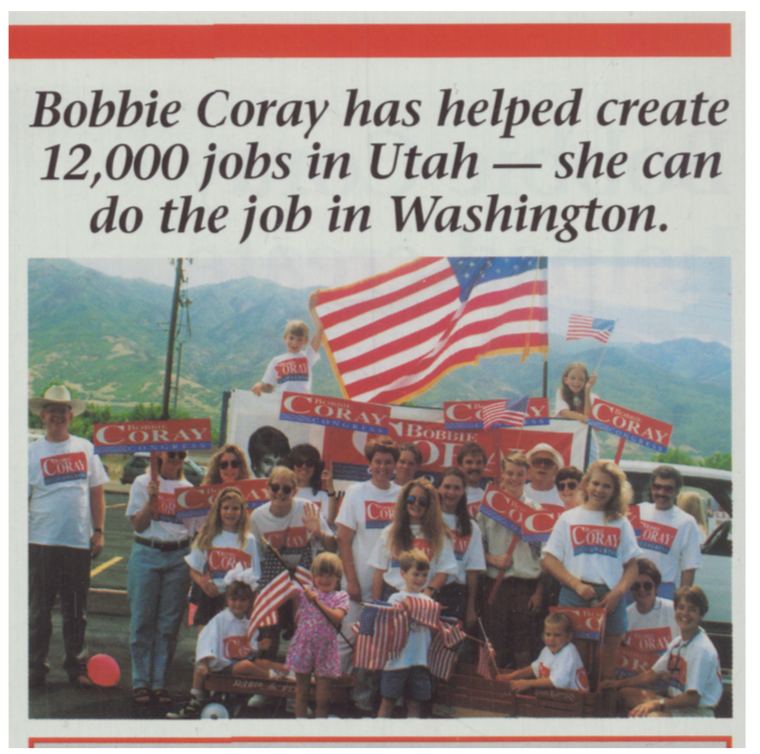 "Upper-right frame of Coray for Congress brochure mailer. Italicized text at the top reads ""Bobbie Coray has helped create 12,000 jobs in Utah – she can do the job in Washington."" Below the text there is a picture containing a mix of children and adults in red, white, and blue Coray for Congress t-shirts, holding similarly designed signs and matching American flags. The crowd appears to be in a parking lot with a telephone pole and hills in the background."