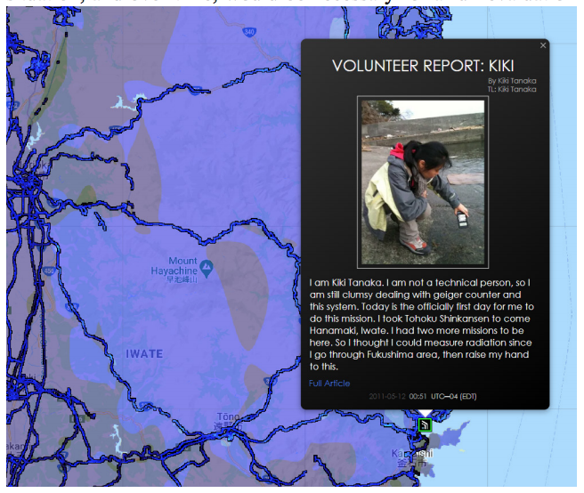 "A screen capture of a blog entry geo-located on the Safecast map. The entry is from a local Japanese woman who describes herself as ""not a technical person"" and includes a photo of her kneeling in the sand near the water holding a Geiger counter."
