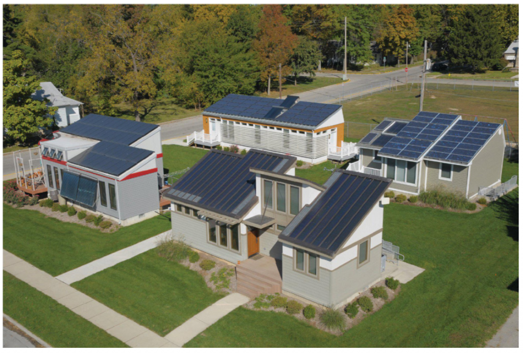 An overhead picture of part of the solar village at Missouri S&T. The photo shows four small houses arranged in a square on a small piece of land.